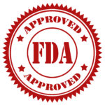 Red stamp with text FDA Approved