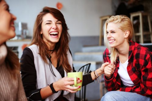 girls laughing about their healthy sex lives